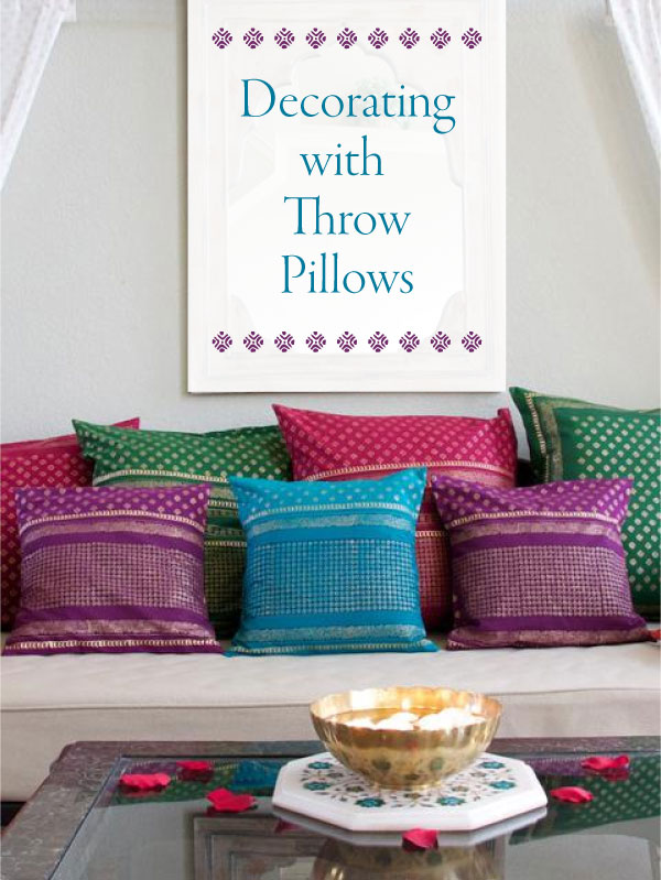 Indian block print pillow covers in various colors on a bench in front of pillows, decorating with throw pillows