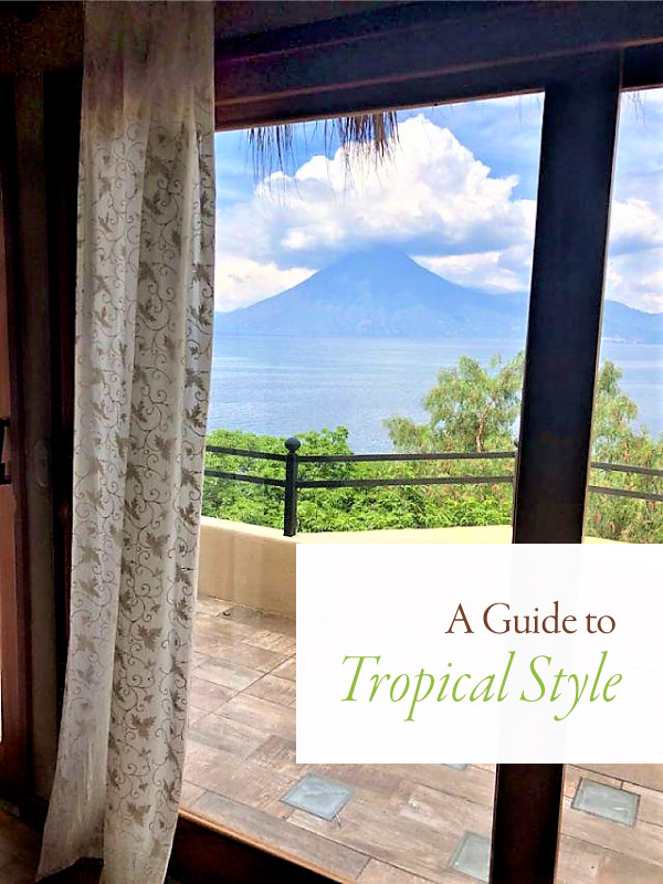 tropical view with blue mountain, water, clouds, and white sheer curtains