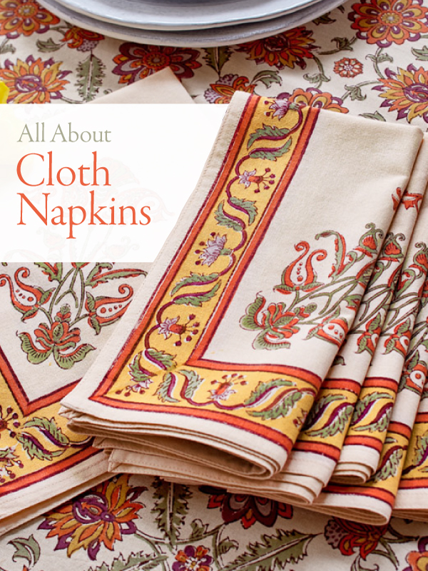 set of orange cotton napkins with text that reads All About Cloth Napkins