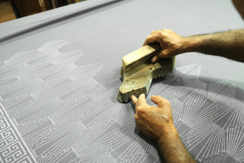 hand block printing and applying bleach paste for grey and white fabric