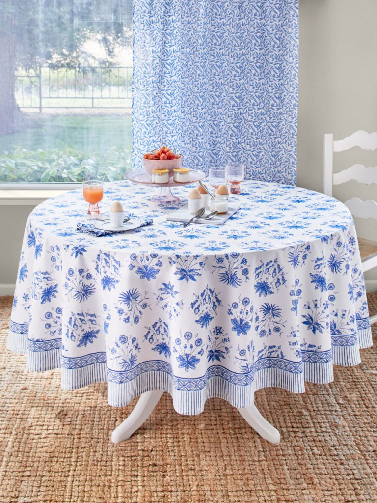 white and blue floral round tablecloth