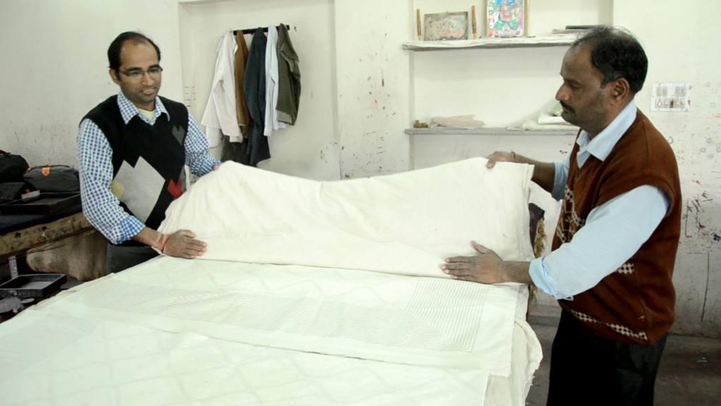 folding linens for discharge printing