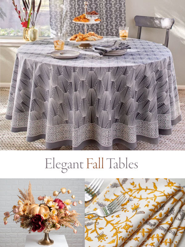 elegant fall tables with grey tablecloth, cloth napkins, and fall centerpiece