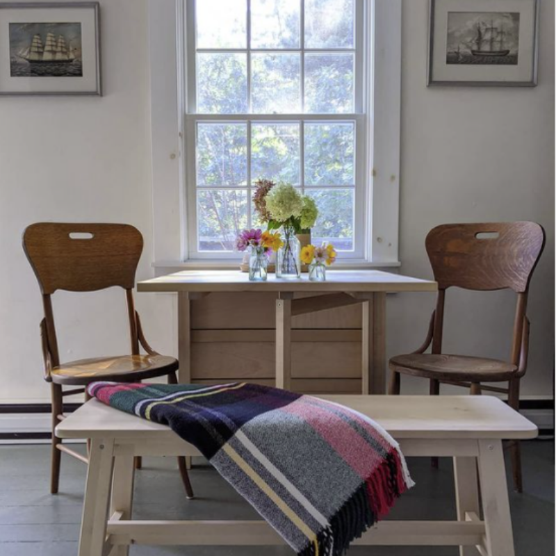 wooden kitchen table and bench in a coastal cottage