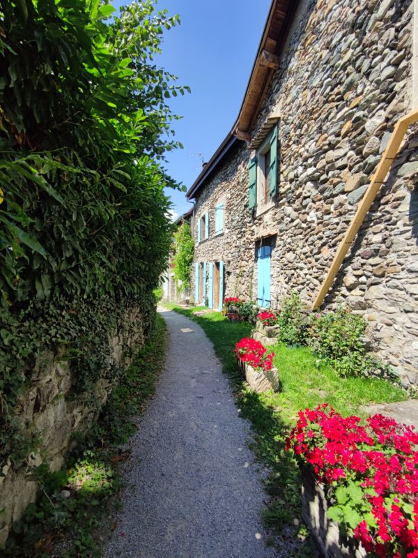 French cottage of stone and a floral pathway
