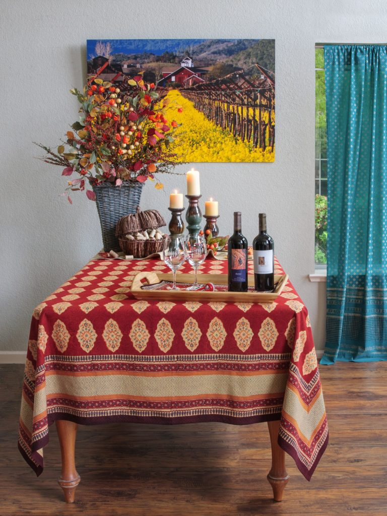 red Thanksgiving tablecloth at a bohemian table setting