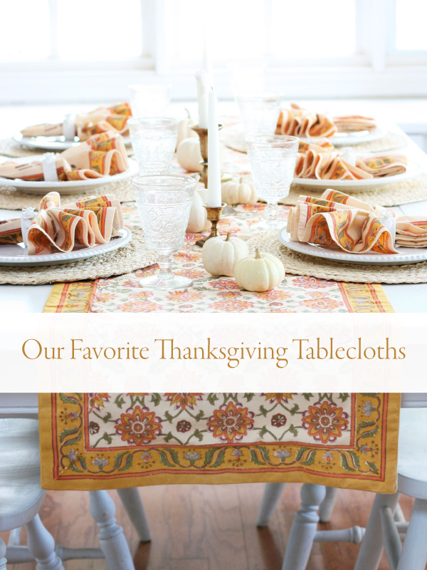 orange tablecloth and white pumpkins with banner that reads Our Favorite Thanksgiving Tablecloths