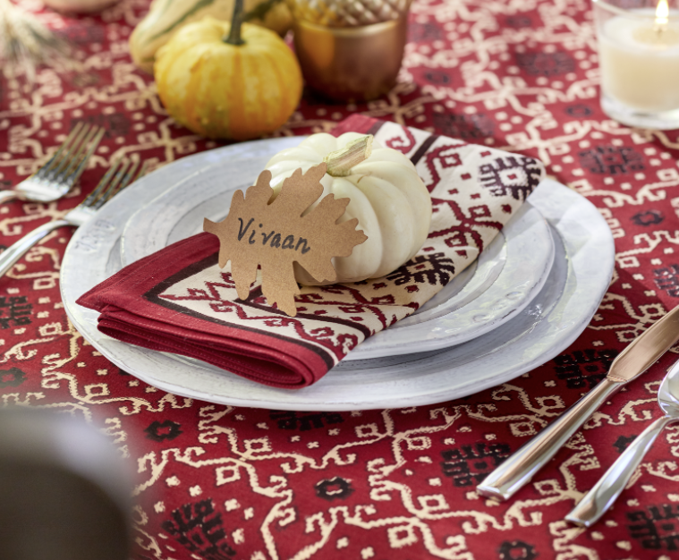 red Thanksgiving tablecloth with white pumpkin and namecard