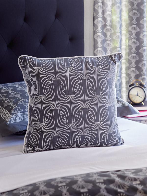 Grey throw pillow in an Art Deco pattern