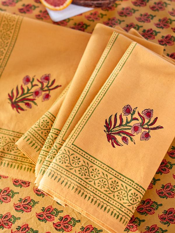orange cloth napkins with block print flower pattern