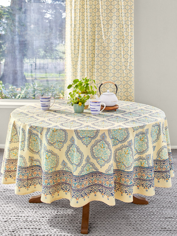 teal and yellow round tablecloth with french moroccan block print