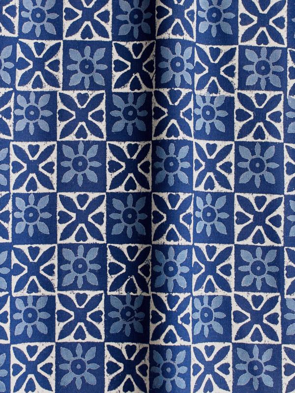 blue block printed fabric made with the dabu process