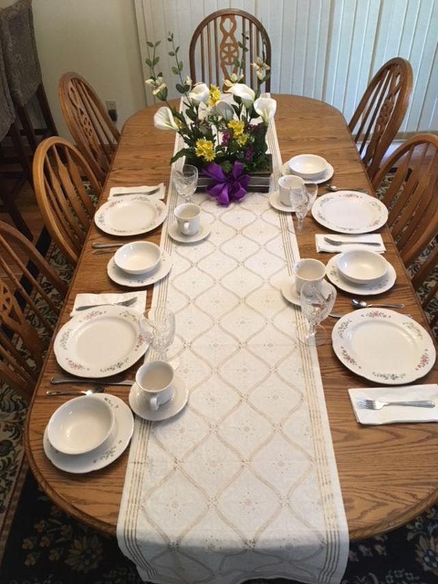 white and gold table runner on an oval table