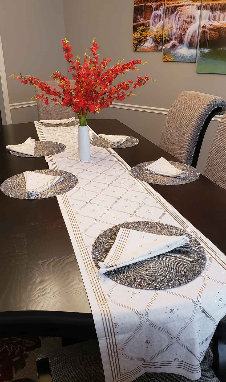 elegant gold and white table runner with centerpiece