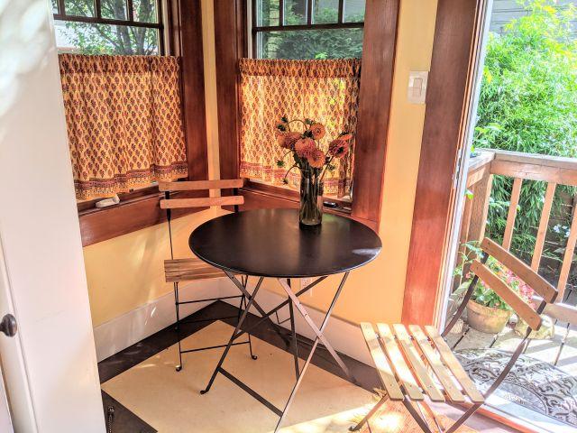 orange cafe curtains in dining nook