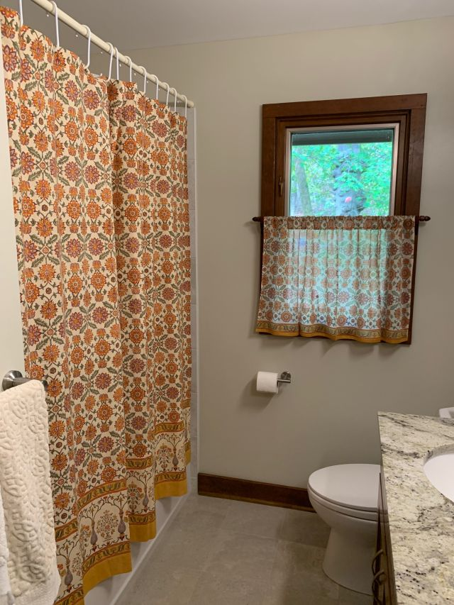 orange floral bathroom window curtain and shower curtain