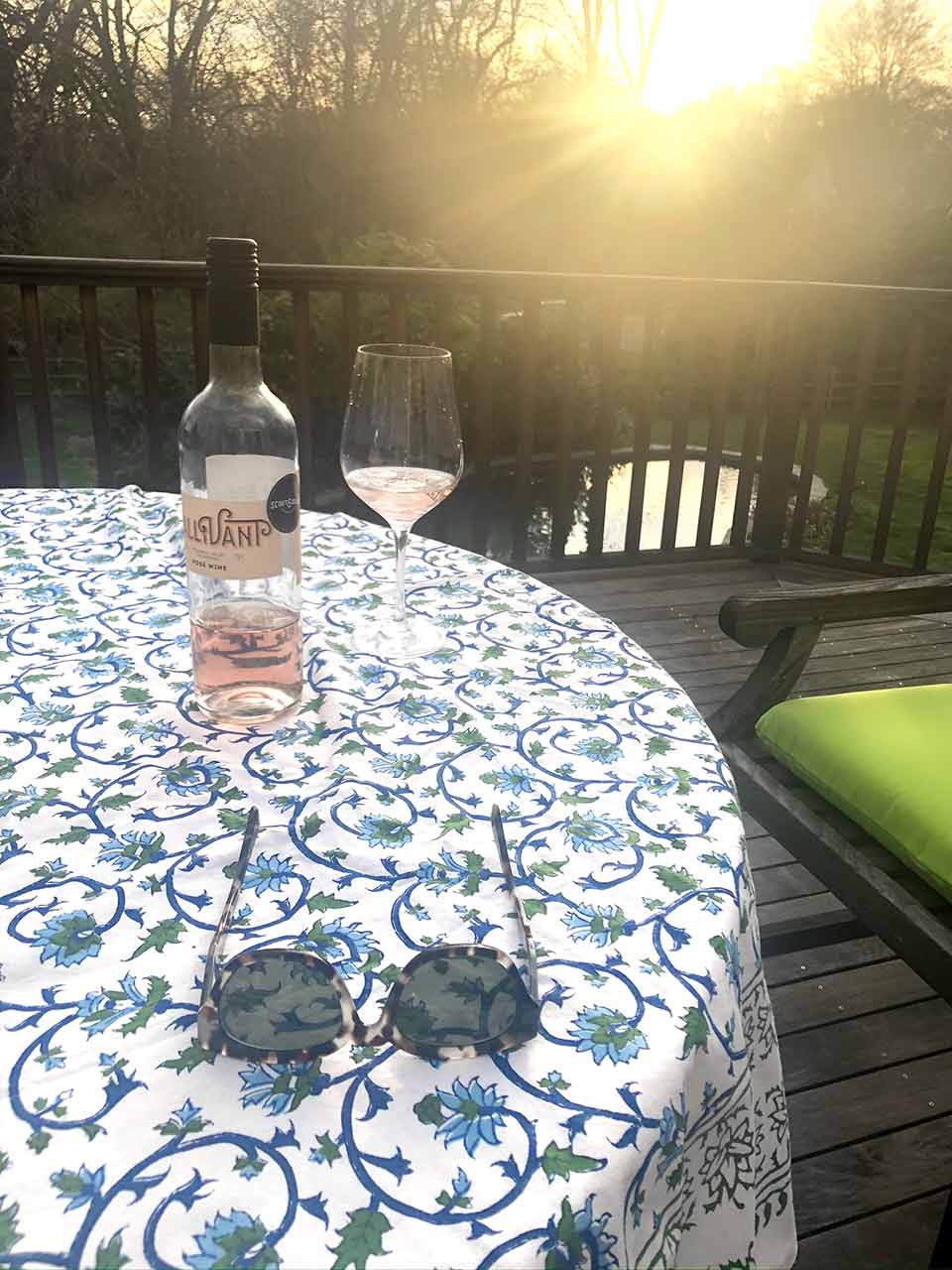 blue and white outdoor summer tablecloths on deck with wine